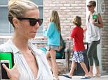 EXCLUSIVE TO INF.\nJuly 02, 2015: Gwyneth Paltrow takes her two kids Apple and Moses to the doctor's at  Hampton Pediatric care center in East Hampton, NY.\nMandatory Credit: Matt Agudo/INFphoto.com Ref: infusny-251
