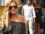 05.JULY.2015 - MONTE CARLO - MONACO\n*** EXCLUSIVE ALL ROUND PICTURES ***\n*** AVAILABLE FOR UK SALE ONLY ***\nAFTER A LUNCH DATE AT A RESTAURANT IN MONTE CARLO BEACH, LINDSAY LOHAN'S MYSTERIOUS DATE OFFERED HER A JEWELLERY SET INCLUDING A SILVER NECKLACE AND EARRINGS FROM MARCO MOLINARIO STORE. EVEN BEING WITH LINDSAY, HER MYSTERIOUS DATE COULDN'T GET HIS EYE AWAY FROM A PRETTY BLONDE GIRL WALKING BY LINDSAY DIDN'T SEEM PLEASED ABOUT IT!\nBYLINE MUST READ : E-PRESS / XPOSUREPHOTOS.COM\n***UK CLIENTS - PICTURES CONTAINING CHILDREN PLEASE PIXELATE FACE PRIOR TO PUBLICATION ***\n**UK CLIENTS MUST CALL PRIOR TO TV OR ONLINE USAGE PLEASE TELEPHONE 0208 344 2007**