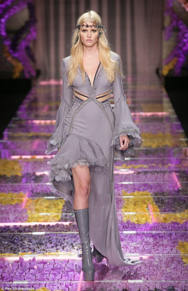 Catwalk Queen: Lara Stone cut a sassy yet serene figure as she strutted down the catwalk in a plunging fairytale-inspired ensemble, at the Atelier Versace show in Paris on Sunday