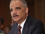 WASHINGTON, DC - MARCH 12:  U.S. Attorney General Eric Holder delivers remarks about the shooting of two police officers in Ferguson, Missouri, while announcing the first six pilot sites for the National Initiative for Building Community Trust and Justice at the Department of Justice March 12, 2015 in Washington, DC. Holder said the shooting of the officers was 'disgusting and cowardly' and called the perpetrator -- who is still at large -- a 'punk.'  (Photo by Chip Somodevilla/Getty Images)