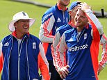 England cricket coach Trevor Bayliss (C) shares a joke with Ben Stokes (R) during an England training session ahead of the Ashes cricket series against Australia at the Swalec stadium in Cardiff on July 7, 2015. AFP PHOTO / GEOFF CADDICK RESTRICTED TO EDITORIAL USE. NO ASSOCIATION WITH DIRECT COMPETITOR OF SPONSOR, PARTNER, OR SUPPLIER OF THE ECBGEOFF CADDICK/AFP/Getty Images