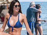 Picture Shows: Flavio Briatore, Elisabetta Gregoraci  July 04, 2015    Flavio Briatore seen with his wife Elisabetta Gregoraci and their son Falco Briatore at the beach while on vacation in Marina di Pietrasanta, Italy.    Non Exclusive  UK RIGHTS ONLY    Pictures by : FameFlynet UK © 2015  Tel : +44 (0)20 3551 5049  Email : info@fameflynet.uk.com