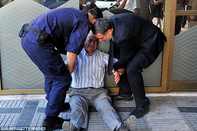 Giorgos Chatzifotiadis was pictured outside a bank in Greece weeping after he was unable to withdraw his weekly pension