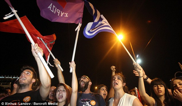 Supporters of the No vote react after the first result of the referendum