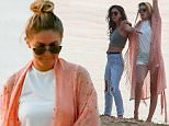 EXCLUSIVE TO INF.\nJuly 06, 2015: Gigi Hadid hangs out with some friends while they pose for photos, skip rocks, and laugh on the beach in Sunset Beach, Shelter Island, NY.\nMandatory Credit: INFphoto.com Ref: infusny-260/294