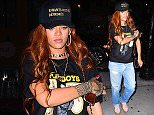 """Rihanna was spotted arriving at an NYC recording studio for a 2am session. She arrived with her tall bodyguard following close behind her, and wore boyfriend jeans and a black tee shirt that said """"Playboys"""", with scantily clad women on it.  Pictured: Rihanna Ref: SPL1072410  060715   Picture by: 247PAPS.TV / Splash News  Splash News and Pictures Los Angeles: 310-821-2666 New York: 212-619-2666 London: 870-934-2666 photodesk@splashnews.com"""