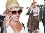 Pink wearing maxi dress to further suspicion that she's pregnant with second child. She has not confirmed that she is with child but she appeears far along July 7, 2015 X17online.com