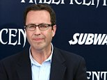 """In this May 28, 2014 photo, Subway restaurant spokesman Jared Fogle arrives at the world premiere of """"Maleficent"""" at the El Capitan Theatre in Los Angeles. FBI agents and Indiana State Police raided Fogle's Zionsville, Ind. home on Tuesday, July 7, 2015, removing electronics from the property and searching the house with a police dog. (Photo by Matt Sayles/Invision/AP)"""