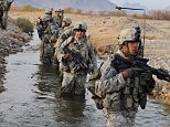 A handout picture released on 06 December 2009 by the NATO's International Security Assistance Force (ISAF) shows US Soldiers from Charlie Company, 1st Battalion, 17th Infantry Regiment, 5th Brigade, 2nd Infantry Division forge a stream during a security patrol in Chabar, Afghanistan 03 December 2009.  US President Barack Obama announced on 01 December, that he is deploying 30,000 additional troops to Afghanistan to step up the fight against Taliban insurgents and forge conditions needed to transfer security responsibility to the Afghan government.  EPA/ISAF / HANDOUT EDITORIAL USE ONLY