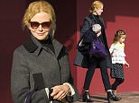 29 JUNE 2015 SYDNEY AUSTRALIA..EXCLUSIVE PICTURES..Nicole Kidman pictured with daughter's Sunday Rose and Faith Margaret arriving at The Orpheum Theatre Neutral Bay to watch the movie 'Minions'. After the movie Nicole took her daughters home then stopped off in Greenwich to pick up her mother Janelle. Nicole and her mother then visited a doctors office in North Sydney. On leaving the clinic Nicole was seen with her hands protectively covering her belly which was concealed by a coat.