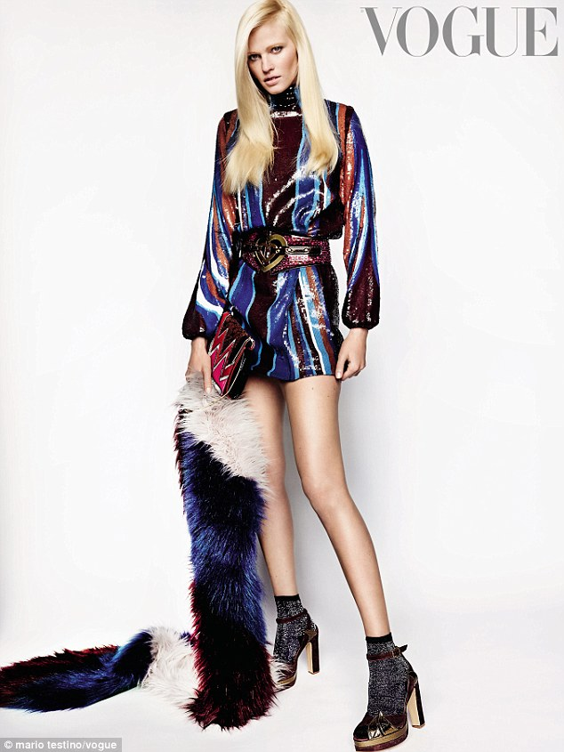 Legs for days: Lara smoulders in a sequinned minidress in one of the pictures shot by Mario Testino