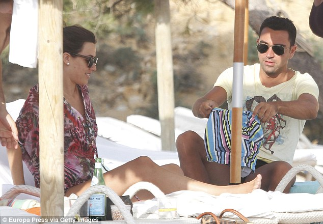 Former Barcelona midfielder Xavi Hernandez enjoys a holiday in Ibiza with his wife Nuria Cunillera