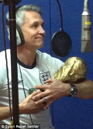 Gary Lineker cradles the World Cup trophy