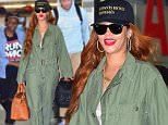 """Rihanna was spotted arriving to NYC on Monday afternoon. She had big smiles on her face as she walked through the terminal of JFK Airport. She carried her own luggage, and her New puppy , """"Pepe"""" in a dog carrier. Her BFF Melissa Forde accompanied her on the flight, as well as her very tall Bodyguard. She wore a green jumpsuit, ray bans and a Black baseball cap.\n\nPictured: Rihanna\nRef: SPL1072279  060715  \nPicture by: 247PAPS.TV / Splash News\n\nSplash News and Pictures\nLos Angeles: 310-821-2666\nNew York: 212-619-2666\nLondon: 870-934-2666\nphotodesk@splashnews.com\n"""