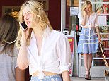 Picture Shows: Elle Fanning  July 06, 2015    'Three Generations' actress Elle Fanning chats on her phone after enjoying lunch in West Hollywood, California.     The 17 year old actress has an incredible line-up of ten films that are set to premiere in 2015 and 2016.     Exclusive - All Round  UK RIGHTS ONLY    Pictures by : FameFlynet UK © 2015  Tel : +44 (0)20 3551 5049  Email : info@fameflynet.uk.com