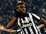 """Juventus' midfielder from France Paul Pogba celebrates after scoring a goal during the Serie A football match Juventus vs Sassuolo at """"Juventus Stadium"""" in Turin on March 09, 2015. AFP PHOTO / GIUSEPPE CACACE        (Photo credit should read GIUSEPPE CACACE/AFP/Getty Images)"""