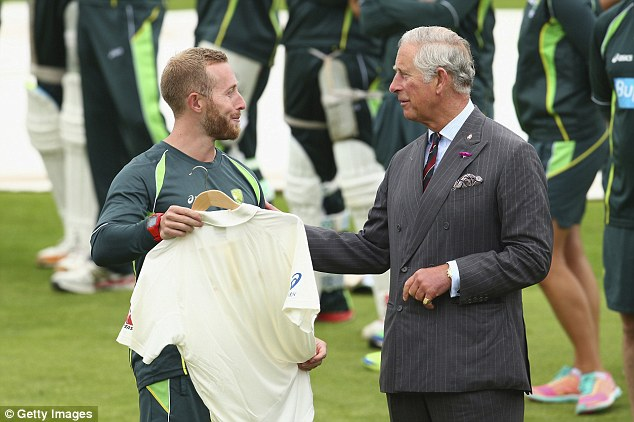 Australian team manager Gavin Dovey presents the Prince of Wales with an Australian Test shirt