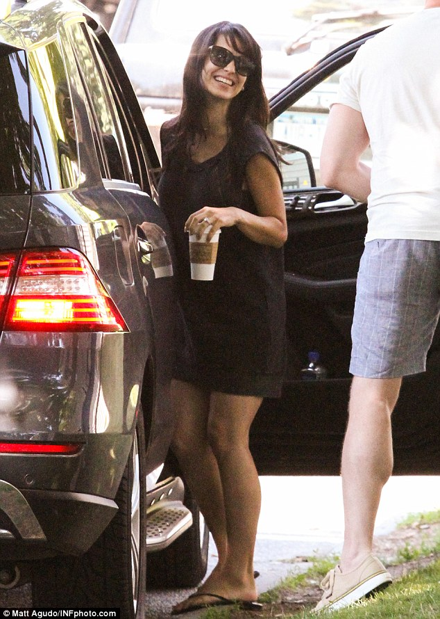 Simple style: Hilaria was seen in a little black sundress and flip-flops as she clutched a coffee on the outing