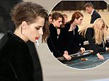 Mandatory Credit: Photo by REX Shutterstock (4897629i)  Kristen Stewart playing roulette on the catwalk  Chanel show, Autumn Winter 2015, Haute Couture, Paris Fashion Week, France - 07 Jul 2015