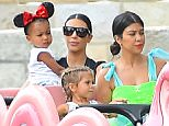 Newly Singl Kourtney kardashian and Pregnant Kim Kardashian celebrate Penelope disick's birthday at Disneyland. the girls were also joined by their mother Kris who had a great time on the dumbo ride. the group were also seen riding the alice in wonderland ride and the carousel  Pictured: Kim Kardashian, Kourtney Kardashian, North West, Penelope disick, Kris Jenner, Mason Disick Ref: SPL1072689  080715   Picture by: Fern / Splash News  Splash News and Pictures Los Angeles: 310-821-2666 New York: 212-619-2666 London: 870-934-2666 photodesk@splashnews.com