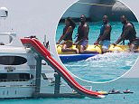 """EXCLUSIVE: The NBA superstars, along with Wade's actress girlfriend Gabrielle Union, were spotted enjoying the off-season like true 'ballers - on a 130ft $17m yacht off the Bahamian island of Staniel Cay. The gang spent at least 3 days anchored off the island, and could be seen having a great time riding jet skis, a banana boat, going down a huge water slide and flying around in a water jet pack. An onlooker said: """"They were definitely having a great time. They had loud music all day. You could see them hanging out and having fun. It was an impressive boat."""" At one point they visited Pig Beach, where tourists can take pictures with wild pigs in the water, but only Gabrielle ventured out to see them. According to one onlooker, LeBron shouted to her """"Those pigs are gonna bite you!"""". Their 3-storey 5-bedroom yacht, the Amarula Sun, is believed to be available for hire from the Bahamian island of Nassau. **NOTE PHOTOS from over the weekend of JULY 4th, 2015**  Pictured: Dwyane Wade goes"""