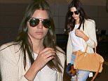 West Hollywood, CA - Model, Kendall Jenner, makes a chic arrival at LAX in a cashmere sweater, tied tee, ripped jeans, tan boots, aviator sunglasses and tan handbag.\nAKM-GSI       July 7, 2015\nTo License These Photos, Please Contact :\nSteve Ginsburg\n(310) 505-8447\n(323) 423-9397\nsteve@akmgsi.com\nsales@akmgsi.com\nor\nMaria Buda\n(917) 242-1505\nmbuda@akmgsi.com\nginsburgspalyinc@gmail.com