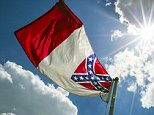 The Confederate flag flies once again on the flag pole outside the McPherson Governmental Complex in Ocala, Fla., on Tuesday, July 7, 2015. The Marion County Commission voted Tuesday to put the flag back up after taking it down recently. (Alan Youngblood/Ocala Star-Banner via AP) MANDATORY CREDIT MAGS OUT