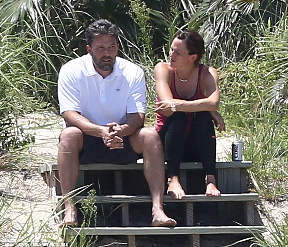 Somber: Ben Affleck and Jennifer Garner are seen having a tense exchange last week during their emotional post-split vacation to the Bahamas with their three children