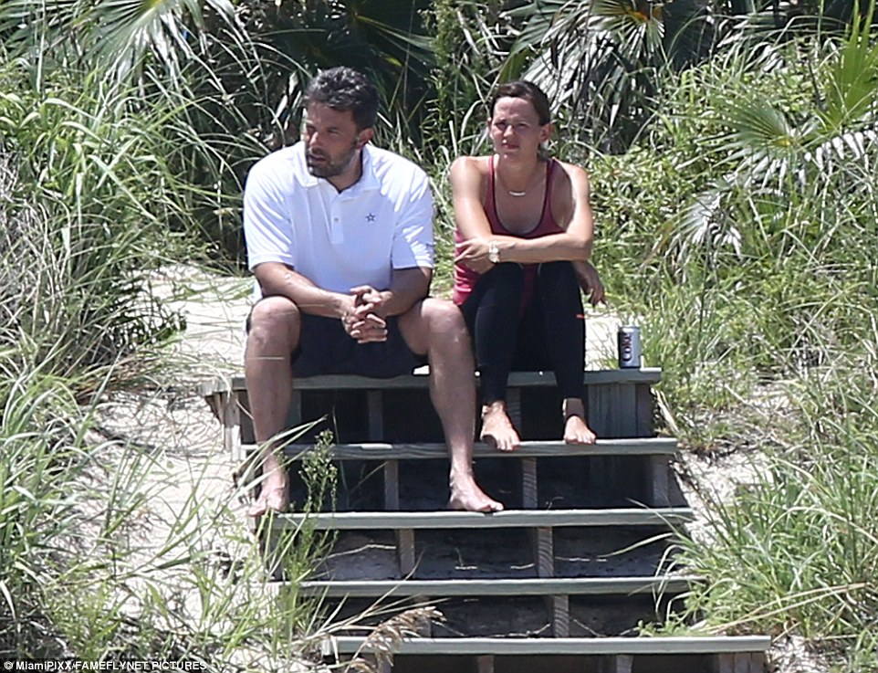 Sad moment: The duo stole a moment away from Violet, nine, Seraphina, six and Samuel, three to have a serious talk before Affleck jetted back to LA