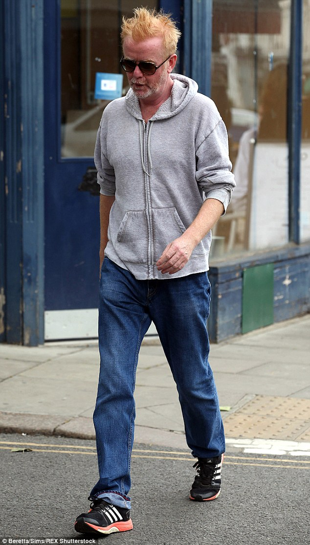 Casual: Chris was dressed down in a grey hoodie, jeans and trainers as he walked through the capital