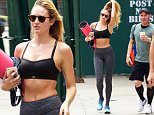 ***MANDATORY BYLINE TO READ INFPhoto.com ONLY***\nCandice Swanepoel shows off her impressive figure after a workout session today in New York City.\n\nPictured: Candice Swanepoel\nRef: SPL1074221  080715  \nPicture by: Alberto Reyes/INFphoto.com\n\n