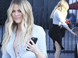 Van Nuys, CA - 'KUWTK' star Khloe Kardashian arrived at the studio in Van Nuys on Monday evening to film a few interviews for her reality show. The blonde babe looked sultry in a curve-hugging pencil skirt, black booties and a denim shirt tied very low with no bra. \nAKM-GSI     July 6, 2015\nTo License These Photos, Please Contact :\nSteve Ginsburg\n(310) 505-8447\n(323) 423-9397\nsteve@akmgsi.com\nsales@akmgsi.com\nor\nMaria Buda\n(917) 242-1505\nmbuda@akmgsi.com\nginsburgspalyinc@gmail.com