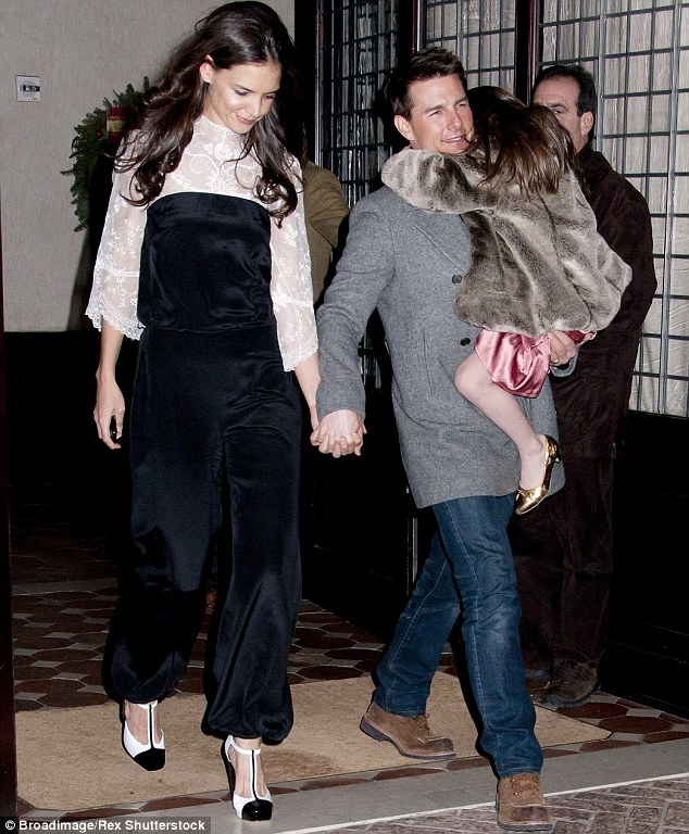 Former flame: Katie famously moved to Chelsea after her high-profile split with Tom Cruise in 2012, as they were pictured together with daughter Suri in New York back in December 2011