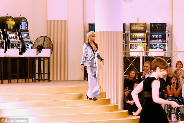 Making her entrance: Rita turned heads as she walked into the room which was studded with casino tables and slot machines