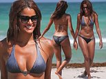 Real Housewives of Atlanta star Claudia Jordan in a triangle top bikini at the beach in Miami Beach, FL. Claudia helped a disabled man who lost his prosthetic leg in the ocean.\n\nPictured: Claudia Jordan\nRef: SPL1073784  080715  \nPicture by: Pichichi / Splash News\n\nSplash News and Pictures\nLos Angeles: 310-821-2666\nNew York: 212-619-2666\nLondon: 870-934-2666\nphotodesk@splashnews.com\n