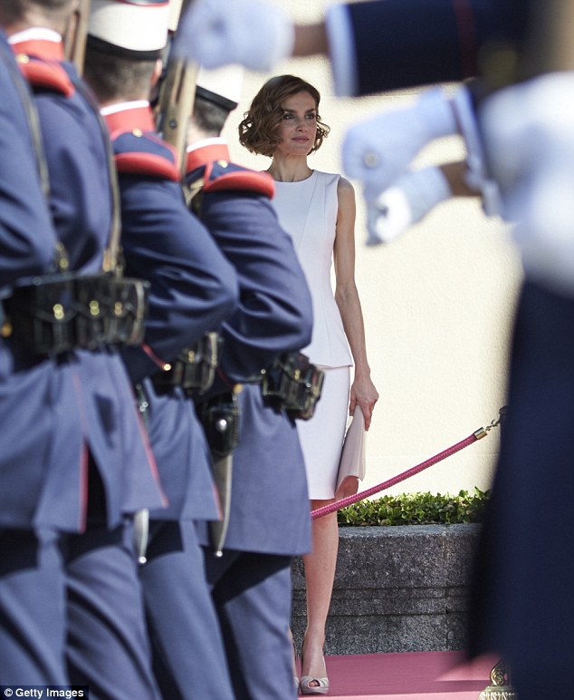 Letizia looked to be enjoying the official welcome which featured marching troops from the Spanish army