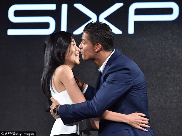 Ronaldo then embraced a delighted-looking fan during the promotion event