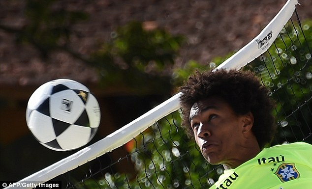 Head: Willian controls the ball during Brazil's training on the beach
