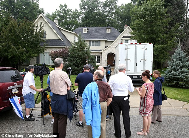 Scandal: Reporters gathered outside Fogle's home on Tuesday, as investigators with the FBI, State Police and Postal Service seized computer hard-drives and other electronics from the house