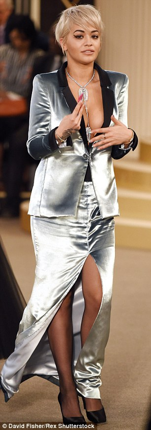 Silver siren: Rita had wowed in a daring silver jacket and matching skirt as the enjoyed Chanel's Haute Couture show during Paris Fashion Week earlier in the day