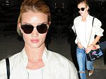 Pictured: Rosie Huntington-Whiteley\nMandatory Credit � Life/Broadimage\nRosie Huntington-Whiteley arriving at the Los Angeles International Airport\n\n7/7/15, Los Angeles, California, United States of America\n\nBroadimage Newswire\nLos Angeles 1+  (310) 301-1027\nNew York      1+  (646) 827-9134\nsales@broadimage.com\nhttp://www.broadimage.com
