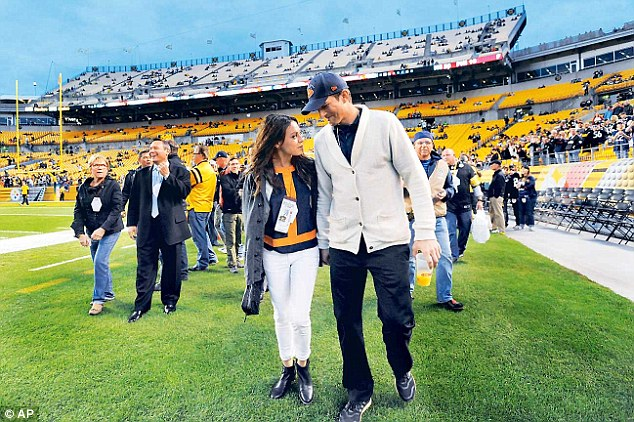 Storied past: The couple - pictured at a Pittsburgh Steelers game in September 2013 - starred on That '70s Show together from 1998 to 2006