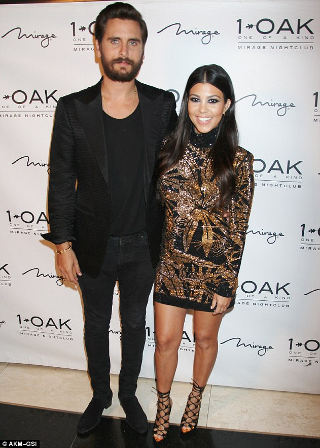 Splitsville: Kourtney Kardashian, right, is said to have dumped her partner of nine years = seen here at 1Oak Nightclub in Las Vegas, Nevada on May 23