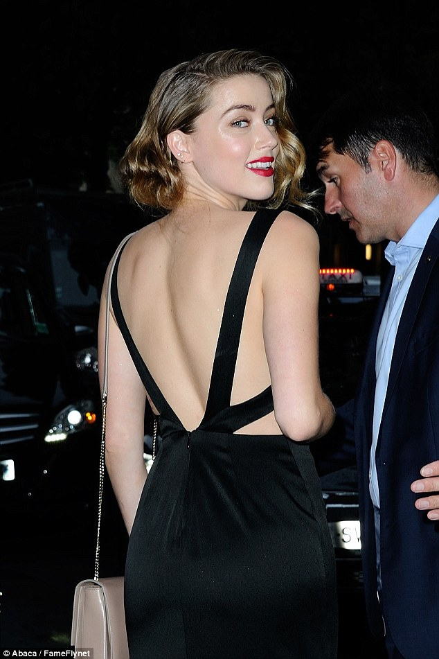 Stunning style! As she entered the Bulgari shop in Paris for the bash, the Magic Mike XXL star made sure the backless design was seen