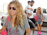 © LOOK PRESS AGENCY\nCODE: QUIMI-ZOOM\n*******EXCLUSIVE*******\nBarcelona airport, 3 July 2015\nSHAKIRA AND PIQUE DEPART ON HOLIDAYS WITH THEIR CHILDREN.\nColombian star singer Shakira and footballer Gerard Pique departed on holidays in a private jet.\nThe couple arrived in the airport with their kids Milan and Sasha, accompanied by two nannies, and two male assistants for the luggage and cars.