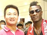 Gyan was given a bouquet of flowers after he jetted into China to put pen to paper on his lucrative deal