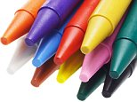 BT0NA2 Close up of multicolor crayon pencils on white background