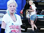 EXCLUSIVE: ** PREMIUM RATES APPLY** Tori Spelling and Dean McDermott move house in Encino, CA.\nSpelling and McDermott were today seen packing up thier rented house in Encino, CA. The couple had some help from possible friends and had hired their own removal truck. At one stage Tori took a couple of carloads of things to a 'Buy,Trade,Sell' outlet where she pocketed some cash before a pharmacy visit, tanning salon hit and finally grocery shopping before heading to a new address.\n\nPictured: TORI SPELLING\nRef: SPL1072366  080715   EXCLUSIVE\nPicture by: Mark Kreusch / Splash News\n\nSplash News and Pictures\nLos Angeles: 310-821-2666\nNew York: 212-619-2666\nLondon: 870-934-2666\nphotodesk@splashnews.com\n
