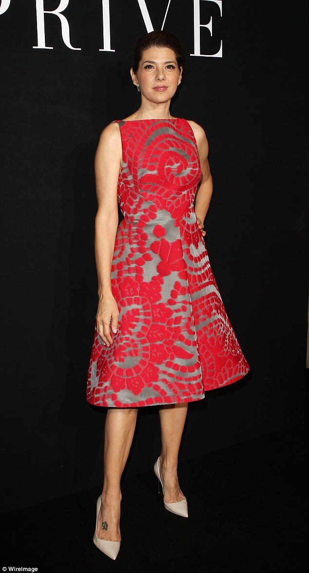 Glamorous: Actress Marisa Tomei went bold in a structured red number