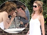 EXCLUSIVE ALL ROUNDER Matt Smith and Lily James enjoy a romantic al fresco dinner together in London. The happy couple kissed and laughed as they ate outside in the balmy summer weather. Please byline: Vantagenews.co.uk